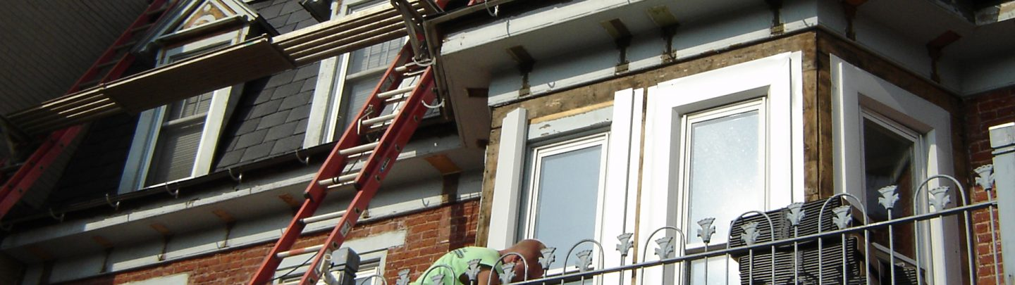 Worker installing a replacement window in Lancaster County, PA
