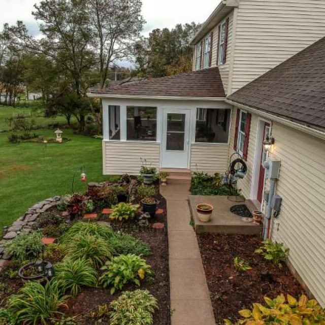screened in porch renovation with matching exterior home siding in york pa