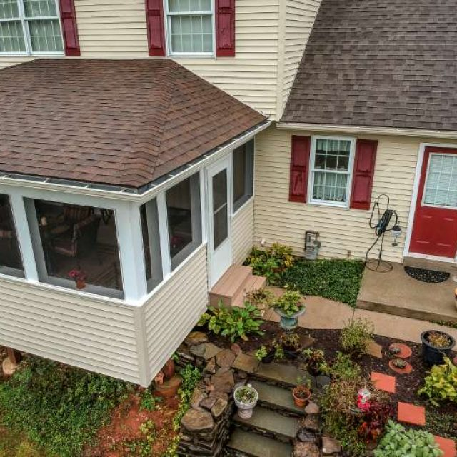 screened in porch renovation with matching roof extension in york pa