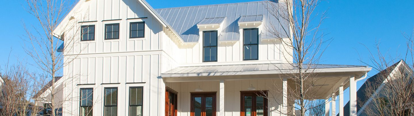 Modern metal roofing on a white siding home